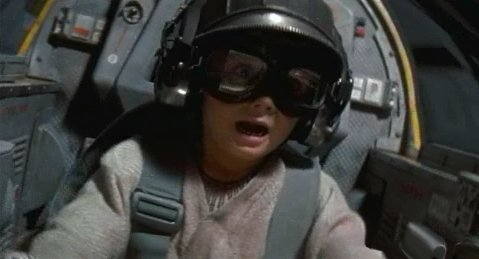 ANAKIN`s ship roars through the hanger deck, bouncing over the DROIDS.